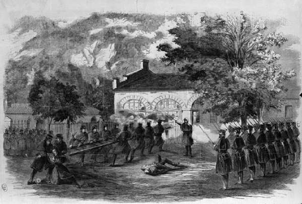 The Harper's Ferry Insurrection–the U.S. Marines Storming the Engine House–Insurgents Firing Through Holes in the Doors